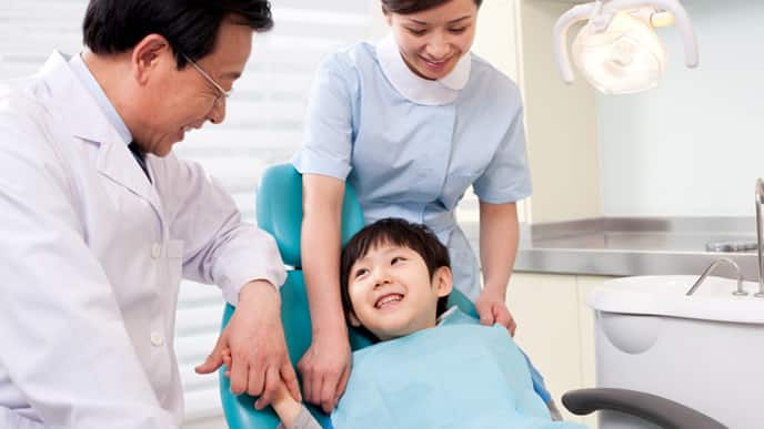 a pediatric dentist explaining to his patient a treatment