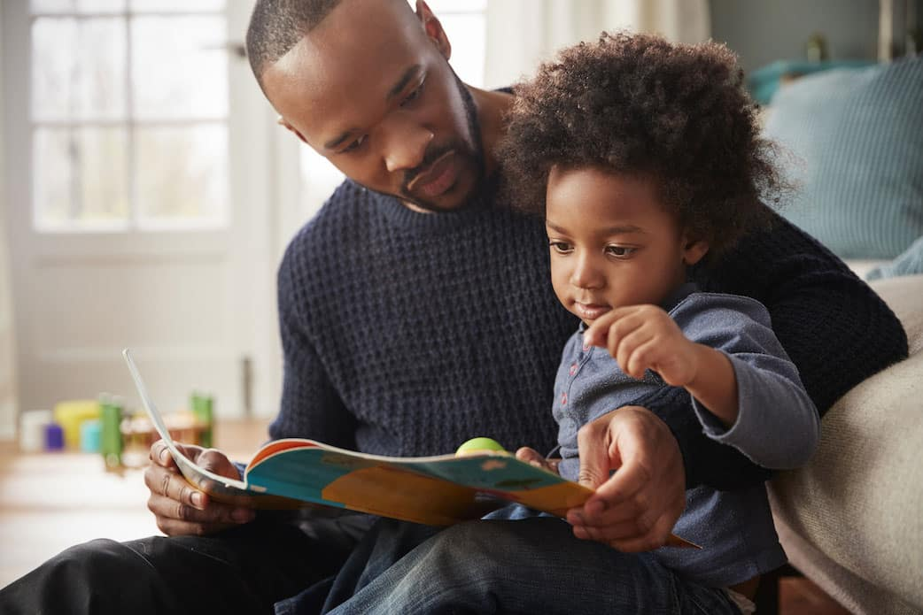 Father Reading to Young Son