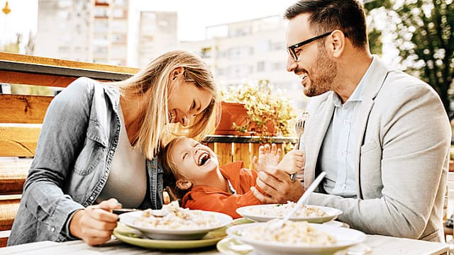 Family Eating Pasta Outdoors