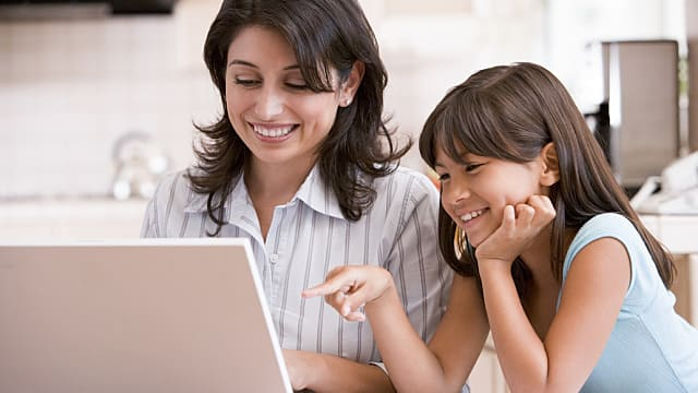Mother and Daughter Looking at Laptop