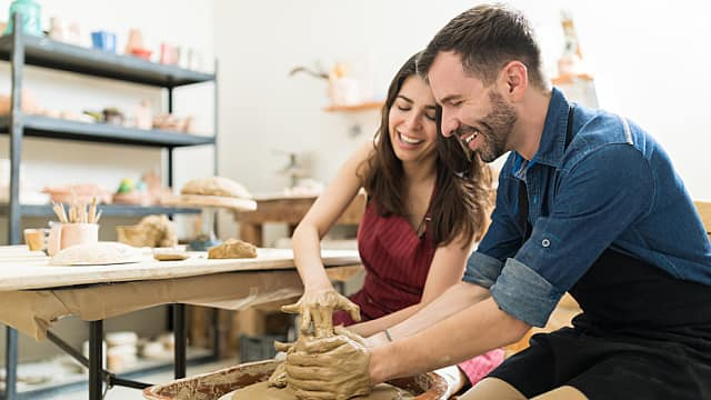 Couple Showing Their Creativity While Dating In Pottery Class
