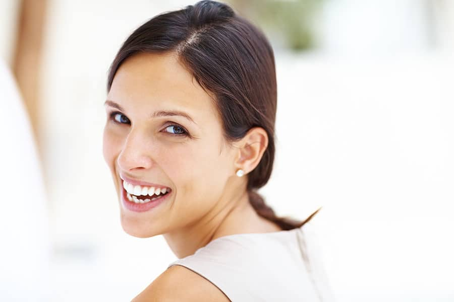 Woman smiling over her shoulder
