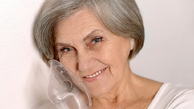 woman with sleep apnea mask