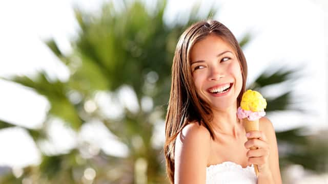 woman smiling eating ice cream