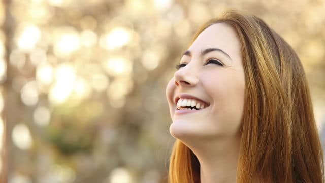 woman looking at sky smiling